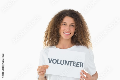 Happy volunteer showing a poster