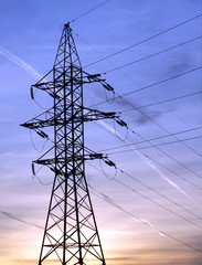 Power supply line metal tower on sunset vertical view