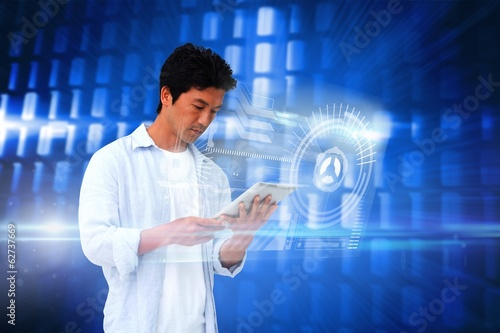 Casual man using tablet with interface