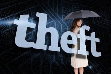 Businesswoman holding umbrella behind the word theft
