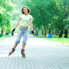 Roller skating sporty girl in park rollerblading on inline skate