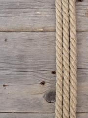 Rope on dark wood