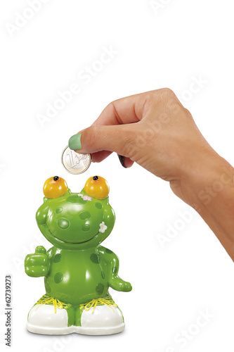 woman hand with Euro near frog money box