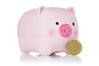 Pink piggy bank and fifty Euro cent