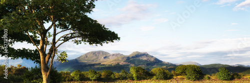 Panorama landscape Snowdonia mountain range Summer evening sunse