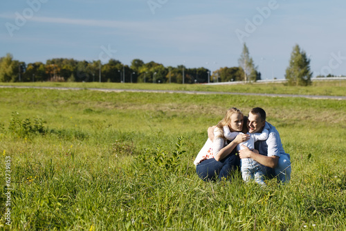 Family of three having fun outdoors