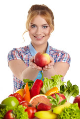 Beautiful woman with vegetables and fruits on table isolated on