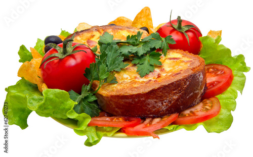 Omelet in bread baked with tomatoes, lettuce and potato chips.