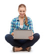 smiling woman with laptop sitting on floor