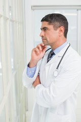 Side view of a thoughtful male doctor in hospital
