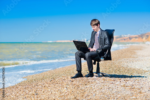 Freelancer working at a laptop.