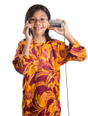 Young Asian girl with smartphone and tin can telephones