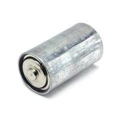 Old salt battery on a white background