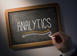 Hand writing Analytics on chalkboard