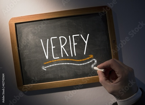 Hand writing Verify on chalkboard