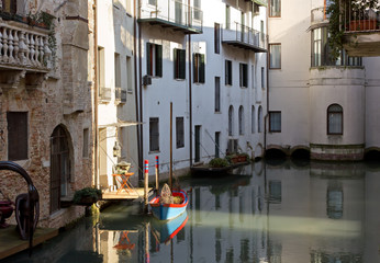 Little Boat Docked Among Houses in Treviso, Italy