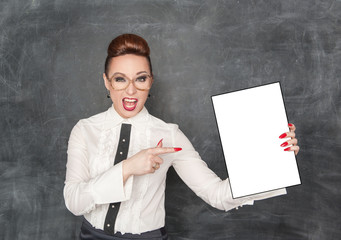 Woman pointing on drawing empty paper in her hand