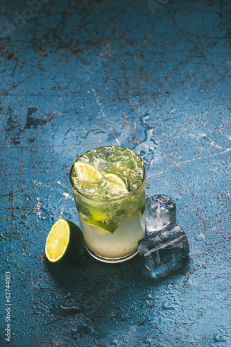 Fresh caipirinha cocktail with lime and ice.
