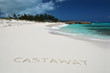 Castaway writing on a desrt beach of Little Exuma, Bahamas