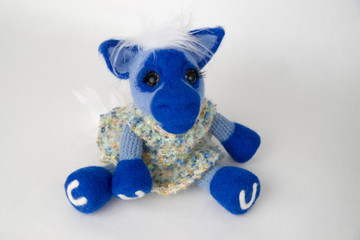 Toy blue horse in a gift