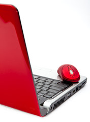 Red computer mouse and red notebook..