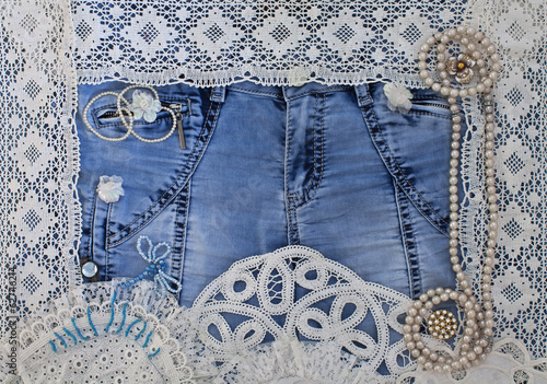 Denim background with lace and women's jewelry