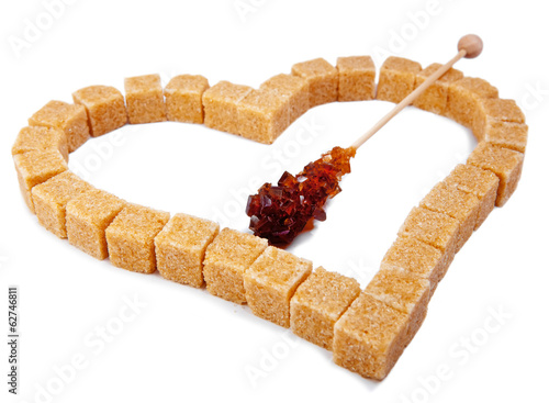 Heart from not refined reed sugar and candy sugar on stick