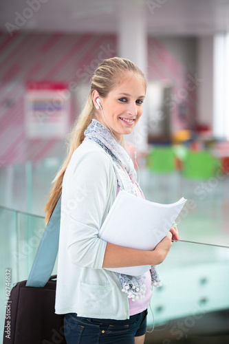 Student on campus - pretty, female student with books