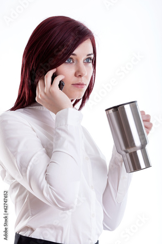 Woman talking by phone and drinking coffee