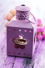 Decorative metallic lantern and artificial flowers