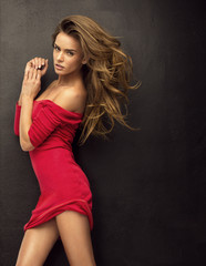 Seductive blond woman in red dress
