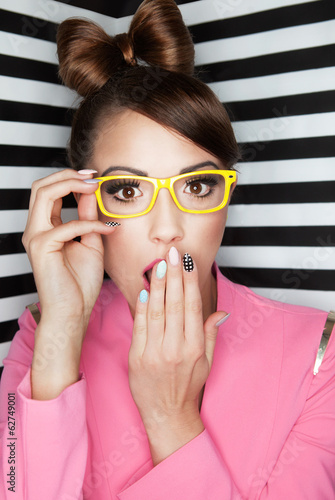 Attractive young surprised woman wearing glasses
