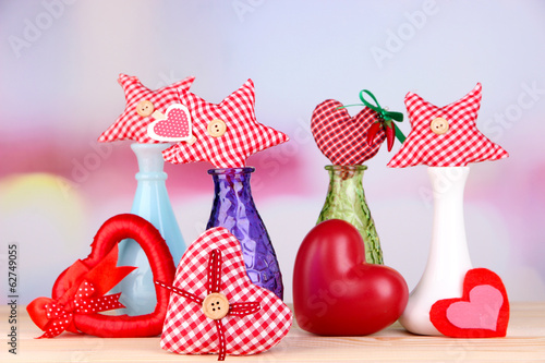 Hand-made textile hearts in different vases