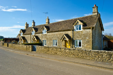 Traditional Cotswold cottages in England, UK. spring.
