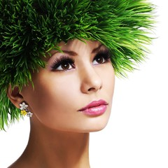 Spring Woman. Beautiful Girl with Green Grass
