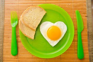 fried egg in the shape of heart
