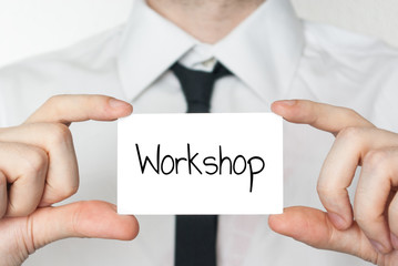 Holding a card with text Workshop