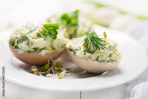 stuffed eggs with fresh herbs and mayonnaise - 62752662