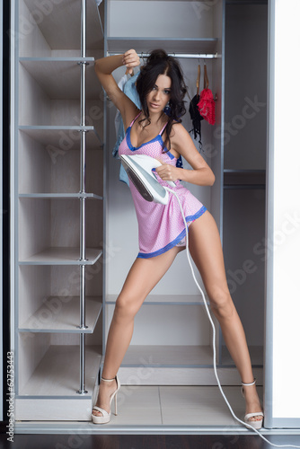 Photo of young  girl in erotic lingerie posing in the interior