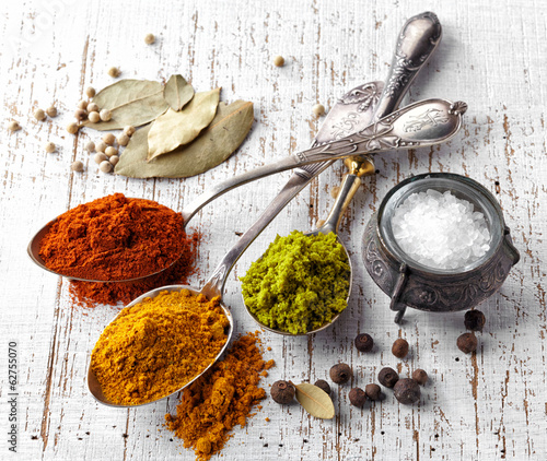 various spices on a white background - 62755070
