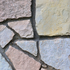 Stone fence background, stonewall closeup, decorative