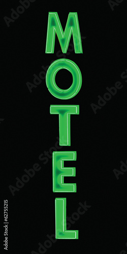 Green Neon Motel sign at night, vertical isolated