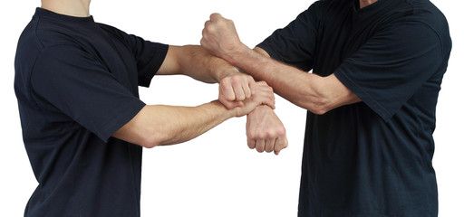 Techniques of Wing Chun are performing two athletes