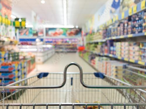 Keuken foto achterwand Boodschappen View from shopping cart trolley at supermarket shop. Retail.
