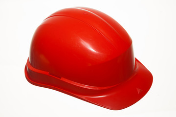 Red safety helmet of builder building worker isolated on white