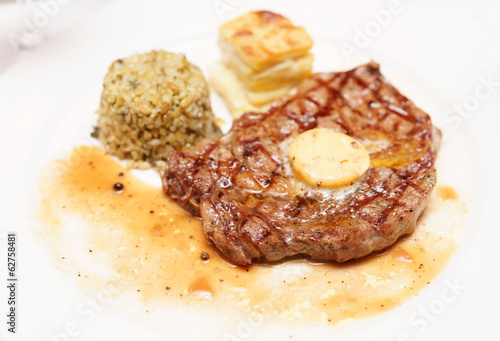 Rib eye steak with bulgur, butter and potato gratin