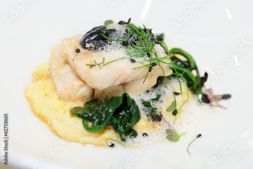 Steamed fish fillet with potato mash and herbs