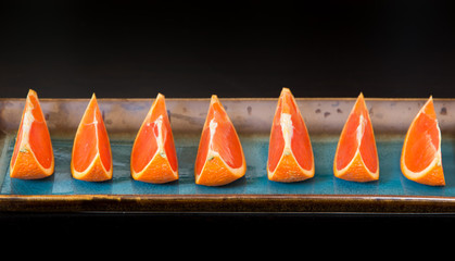 Slices of  the cara cara oranges with its pinkish red color inte