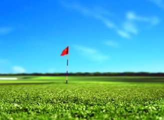 Golf Course Landscape with Red Flag