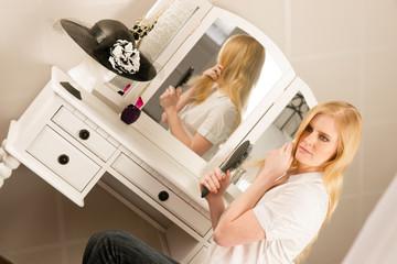 Beautiful Blonde Woman Brushing Hair Bedroom Vanity Natural